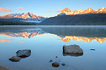 Idaho, South Central, Sawtooth National Recreation Area. Stanley. Redfish Lake on a summers morning reflectes the Sawtooth Range in the steaming, calm waters.