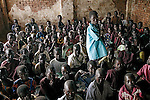 LALIYA, UGANDA AUGUST 5: Young school children wait for their teacher during a class at St. Martine Primary School on Aug 5, 2005 in Laliya, Uganda. Many children in Northern Uganda are afraid of being abducted by the Lord's Resistance Army (LRA). The rebel group has brought terror to Northern Uganda for almost twenty years, fighting the Ugandan government. The victims are usually children, which are abducted and used as child soldiers and sex slaves. (Photo: Per-Anders Pettersson)..