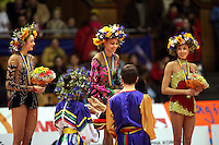 (L-R) Anna Bessonova and Natalya Godunko of Ukraine and Inna Zhukova of Belarus win 2nd, 1st, 3rd respectively in the All-Around competition at 2006 Deriugina Cup Grand Prix in Kiev, Ukraine on March 18, 2006. (Photo by Tom Theobald)