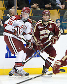 Jimmy Vesey (Harvard - 19), Patrick Wey (BC - 6) - The Boston College Eagles defeated the Harvard University Crimson 4-1 in the opening round of the 2013 Beanpot tournament on Monday, February 4, 2013, at TD Garden in Boston, Massachusetts.