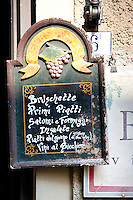 Chalk board restaurant menu of La Bottega di Giovannino with local specialities on offer in Radda-in-Chianti, Tuscany, Italy