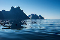 Steep mountains rise from the sea on the northern side of Moskenesøy, Lofoten Islands, Norway