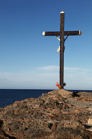View from behind of huge cross with a sculpture of Christ crucified, Chapelle St Vincent, 1642, Collioure, France, with the sea in the background. Picture by Manuel Cohen.
