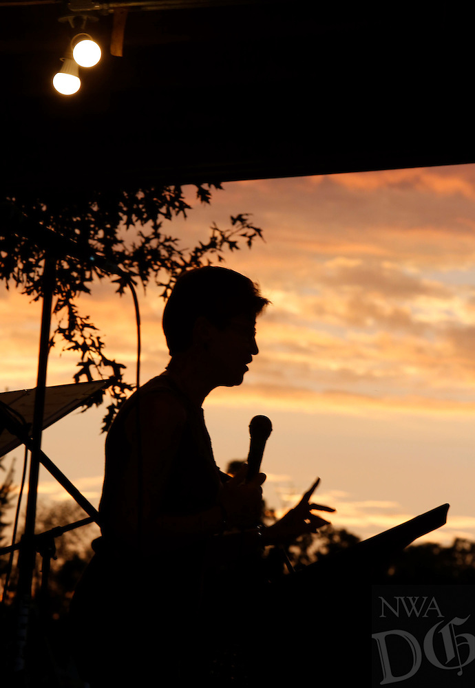 NWA Democrat-Gazette/DAVID GOTTSCHALK  Carol Heymsfield shares a testimonial Monday, September 28, 2015 during Gather at the River, a celebration at Bunch Park in Elkins. The event took place over three nights sharing a message, music and community.