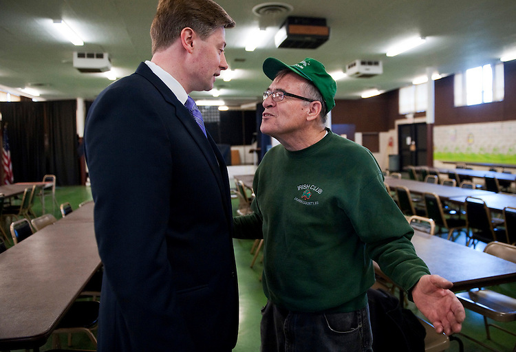 UNITED STATES - APRIL 9:  Rep. Jason Altmire, D-Pa., left, talks with Norman Murphy, 72, after Altmire conducted a town hall meeting at the Circle of Friends Senior Center in Beaver Falls, Pa.  (Photo By Tom Williams/CQ Roll Call)