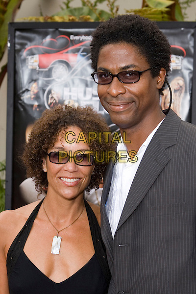 """STEPHANIE ALLAIN & GUEST.At the """"Hustle & Flow"""" Los Angeles Film Premiere,.held at the Arclight Cinerama Dome, .Hollywood, California, USA, 20th July 2005..portrait headshot sunglasses.Ref: ADM.www.capitalpictures.com.sales@capitalpictures.com.©Zach Lipp/AdMedia/Capital Pictures."""