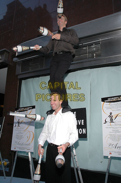 """26 July 2005 - New York, New York - John Wee and Owen Morse of """"The Passing Zone"""" show off their skills as they arrive at the premiere of their new film, """"The Aristocrats"""", at The Directors Guild Theater in Manhattan.  .Photo Credit: Patti Ouderkirk/AdMedia"""