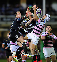 Matthew Morgan of Cardiff Blues competes with Jack Wilson and Tom Homer of Bath Rugby for the ball in the air. European Rugby Challenge Cup match, between Bath Rugby and Cardiff Blues on December 15, 2016 at the Recreation Ground in Bath, England. Photo by: Patrick Khachfe / Onside Images