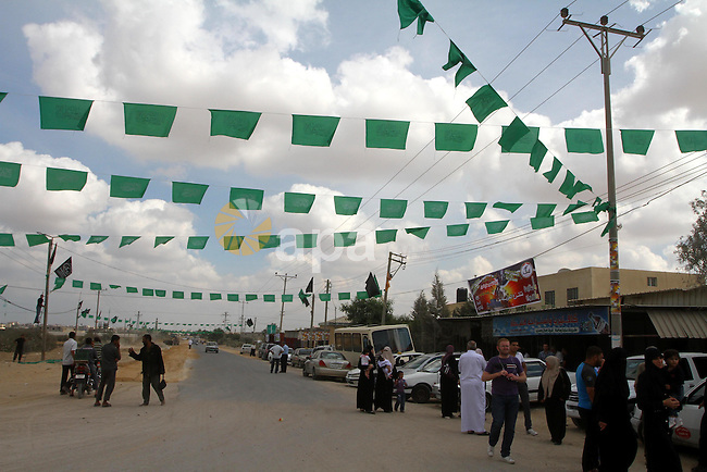 Palestinians gather at the Rafah border crossing in the southern Gaza Strip October 17, 2011, during preparations for the release of prisoners in a swap that is expected to take place on Tuesday. Hamas prepared a heroes' welcome in Gaza for 295 of the prisoners due to be sent to the Israeli-blockaded territory. Palestinians regard brethren jailed by Israel as prisoners of war in a struggle for statehood. Israel holds some 6,000 Palestinian prisoners. Photo by Ashraf Amra