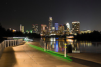 The Boardwalk Trail at Lady Bird Lake offers glimmering views of the downtown Austin skyline.