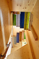 The artist Richard Woods has built a timber house where he can both create and showcase his bold, bright work. The scent of timber pervades the interior with floors of solid oak and walls constructed from cross laminated timber panels. The stairs feature Wood's woodgrain pattern in various bright colours.