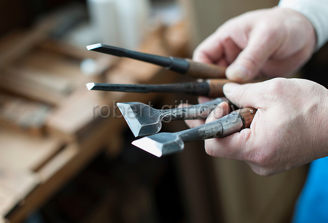 "Tsutomu Ohashi, 51, shows the different types of ""nome"" cutting implements used in the making of kiri-tansu furniture at Kamo Kiri-tansu maker Asakura Kagu in Niigata City, Niigata Prefecture Japan on Feb. 21, 2017. ROB GILHOOLY PHOTO"
