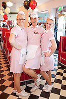 "NO REPRO FEE. 26/5/2011. NEW EDDIE ROCKET'S SHAKE SHOP. Ola Machnik, Alexandra Orban and Mihaela Orban are pictured in the new Eddie Rocket's Shake Shop. The design seeks to recall the vintage milkshake bars from 1950's America and re-imagine them for the 21st century. The new look aims to appeal to both young and old with a quirky and bold colour scheme and a concept of make-your-own milkshakes, based on the tag line ""You make it...We shake it!"". Eddie Rocket's City Diner in the Stillorgan Shopping Centre in south Dublin has re-opened after an exciting re-vamp and the addition of a Shake Shop. Ten new jobs have been created with the Diner's re-launch bringing the total working in Eddie Rocket's Stillorgan to 30. Picture James Horan/Collins Photos"