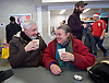 Crisis at Christmas, London, Great Britain <br /> 23rd December 2016 <br /> <br /> <br /> Kenneth Pigram from Canning Town and Lesley Trahar from Dagenham <br /> share a cuppa <br /> <br /> First day of operations at one of the Crisis centres in London.<br /> <br /> Crisis at Christmas is a lifeline for thousands of homeless people across the UK, offering support, companionship and vital services over the festive period.<br />  <br /> Crisis at Christmas provides immediate help for homeless people at a critical time - one in four homeless people spends Christmas alone - but our work does not end there. We encourage guests to take up the life-changing opportunities on offer all year round at our centres across the country. <br />  <br /> Crisis is the national charity for homeless people.<br /> <br /> Crisis reveals scale of violence and abuse against rough sleepers as charity opens its doors for Christmas<br /> <br /> People sleeping on the street are almost 17 times more likely to have been victims of violence and 15 times more likely to have suffered verbal abuse in the past year compared to the general public, according to new research from Crisis, the national charity for homeless people.<br />  <br /> <br /> Photograph by Elliott Franks <br /> Image licensed to Elliott Franks Photography Services