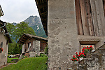 Barns in the town of Stampa, Switzerland where Swiss sculptor Alberto Giacometti was born with the mountains of the Valley Bregaglia in the background
