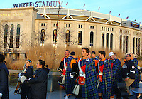 Members of Notre Dame's marching band the Irish Guard walking to Yankee Stadium after pre game performance at the Macombs Park across from Yankee Stadium prior to Notre Dame vs. Army football game on Saturday, November 20, 2010. Photo by Errol Anderson.