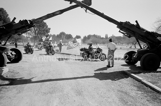 Tucson, Arizona.USA.March 16, 2007..The Patriot Guards arrive under two Howitzer artillery guns at the Evergreen Cemetery for the funeral of Staff Sgt. Darrel D. Kasson, 43, of Florence, Arizona. He died March 4 in Tikrit, Iraq, of wounds suffered when an improvised explosive device detonated near his vehicle at Bayji, Iraq. He was assigned to the 259th Security Forces Company, Phoenix.