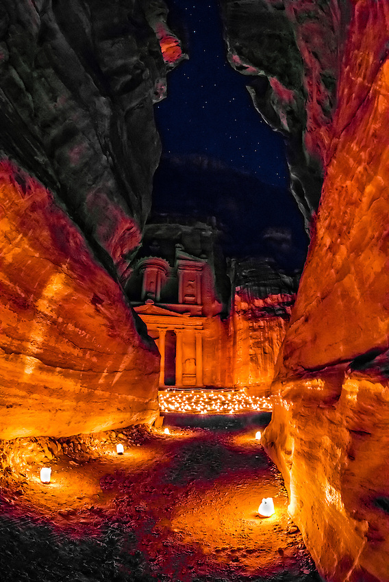 "Approaching the Treasury (Al-Khazneh) from the Siq (a 1200 meter long gorge) in the Petra archaeological site (a UNESCO world heritage site), Jordan. The length of the Siq and the area around the Treasury is candlelit for ""Petra by Night""."
