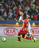 U.S. forward Clint Dempsey is fouled in the Ghana penalty area, prompting a spot kick, which leveled the score in the 62nd minute. Ghana defeated the U.S., 2-1, in extra time to advance to the quarterfinals, Saturday, June 26th, at the 2010 FIFA World Cup in South Africa..