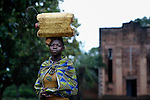 A girl in Riimenze, a village in Southern Sudan's Western Equatoria State, carries a jerry can of water home from a well. In the background is the village's Catholic church. NOTE: In July 2011 Southern Sudan became the independent country of South Sudan.