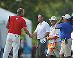 Robert Karlsson (left) congratulates winner Harrison Frazar at the PGA FedEx St. Jude Classic at TPC Southwind in Memphis, Tenn. on Sunday, June 12, 2011. Harrison Frazar won the tournament on the third playoff hole against Robert Karlsson. The victory was Frazar's first ever on the PGA tour.