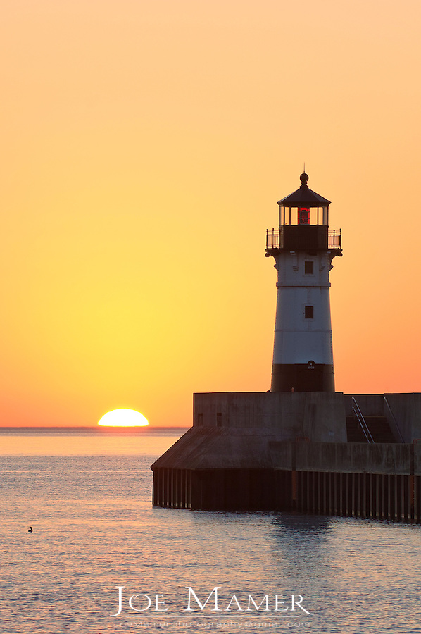 Sunrise at the north breakwater lighthouse at the entry to Duluth Harbor in Duluth, Minnesota.