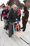 Women Standing on Kicksled in Kolkja Kelk, Tartu County, Estonia