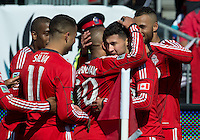 30 March 2013:Toronto FC players celebrate a goal by Toronto FC midfielder Jonathan Osorio #21 during an MLS game between the LA Galaxy and Toronto FC at BMO Field in Toronto, Ontario Canada..The game ended in a 2-2 draw..