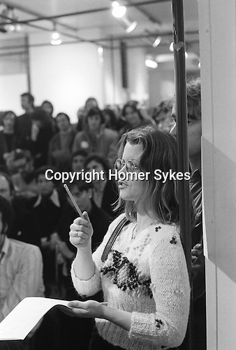 """The Photographers Gallery Great Newport Street London 1971. """"Co Optic"""" Christmas Print Auction. Catherine Saunders, and photographer Colin Curwood behind her."""