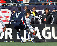 New England Revolution defender Kevin Alston (30) dribbles down the wing.  In a Major League Soccer (MLS) match, Sporting Kansas City (blue) tied the New England Revolution (white), 0-0, at Gillette Stadium on March 23, 2013.