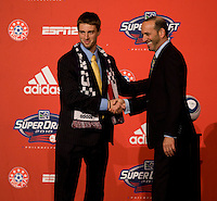 MLS commissioner Don Garber welcomes Blair Gavin of Akron to the stage as the tenth overall pick of  the MLS Superdraft by Chivas USA at the Pennsylvania Convention Center in Philadelphia, PA.
