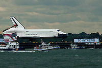 Space Shuttle Enterprise makes its way up by Hudson River to be placed at the Intrepid Sea, Air and Space Museum in New York, June 6, 2012.  Photo by Kena Betancur / VIEW..