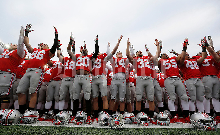 The team sings Carmen Ohio following the NCAA football game against Michigan at Ohio Stadium on Saturday, November 29, 2014. (Columbus Dispatch photo by Jonathan Quilter)
