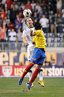 Heath Pearce (14) of the United States (USA) and Falcao Garcia (9) of Colombia (COL). The men's national teams of the United States (USA) and Colombia (COL) played to a 0-0 tie during an international friendly at PPL Park in Chester, PA, on October 12, 2010.
