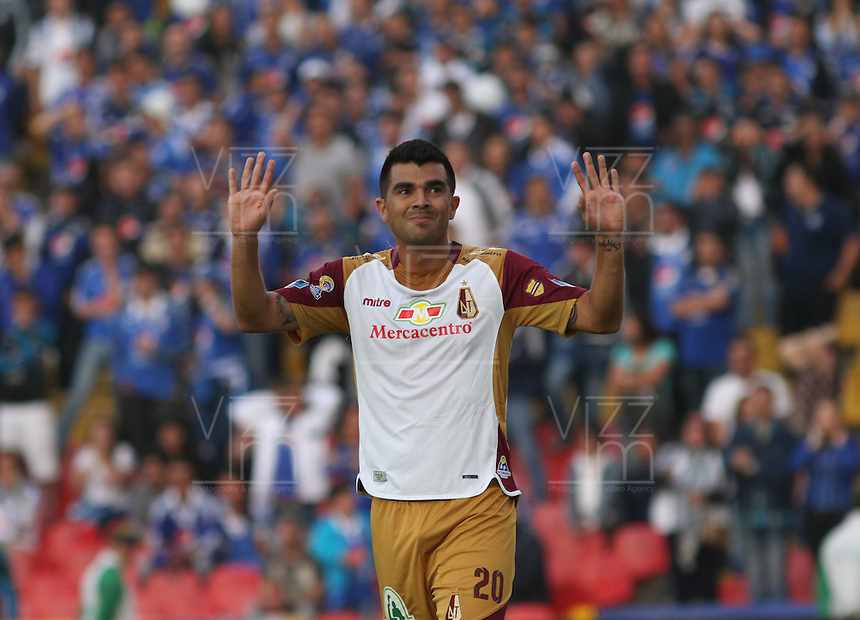 BOGOTÁ -COLOMBIA-28-02-2016. Harrison Otalvaro  del Tolima celebra su gol contra Millonarios durante partido por la fecha 7 de Liga Águila I 2016 jugado en el estadio Nemesio Camacho El Campin de Bogotá./ Harrison Otalvaro  of Tolima celebrates his goal against of Millonarios  during the match for the date 7 of the Aguila League I 2016 played at Nemesio Camacho El Campin stadium in Bogota. Photo: VizzorImage / Felipe Caicedo / Staff