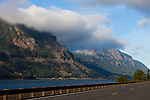 The view of mist clinging to the mountains in the Columbia River Gorge at sunrise along Highway 14 in Washington State