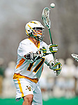 10 April 2011: University of Vermont Catamount attacker Drew Philie, a Sophomore from Sandwich, MA, in action against the University at Albany Great Danes on Moulton Winder Field in Burlington, Vermont. The Catamounts defeated the visiting Danes 11-6 in America East play. Mandatory Credit: Ed Wolfstein Photo