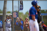 Fans line up at the fence to take pictures of New York Mets outfielder Tim Tebow (15) at bat during an Instructional League game against the Miami Marlins on September 29, 2016 at Port St. Lucie Training Complex in Port St. Lucie, Florida.  (Mike Janes/Four Seam Images)
