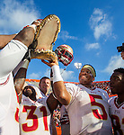 Quarterback Jameis Winston (5), Terrence Brooks (31), Kenny Shaw (81) and teammates hoist a mounted Gator head after  the #2 ranked Florida State Seminoles 37-7 victory over the Florida Gators at Ben Hill Griffin Stadium in Gainesville, Florida November 30, 2013.  Florida State had an undefeated regular season at 12-0.