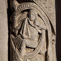 Stone carving of a woman holding scales representing Libra, the sign of the zodiac, from a column on the central bay of the Royal Portal, 1142-50, Western facade, Chartres cathedral, Eure-et-Loir, France. Chartres cathedral was built 1194-1250 and is a fine example of Gothic architecture. It was declared a UNESCO World Heritage Site in 1979. Picture by Manuel Cohen