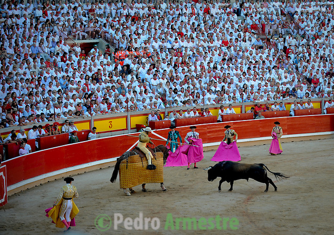 Matador take part in a bullfight of the San Fermin festival at Pamplona's bullring on July 8, 2012, in Pamplona, northern Spain. The festival is a symbol of Spanish culture that attracts thousands of tourists to watch the bull runs despite heavy condemnation from animal rights groups . (c) Pedro ARMESTRE