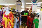 Wailani Tanaka and husband Dave Mirelas at Tanaka's store, Something for Everybody, a boutique in Kaunakakai that sells hand printed clothing made by local artists, along with other local hand made gifts.  Ms. Tanaka also offers classes in lei making, hula and ukulele as well as advice for travelers to her island of Molokai, Hawaii, USA