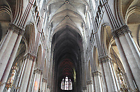 Low angle view of the high vaulted Gothic ceiling with clerestories, triforium and tiered arches to the either side, nave, Notre-Dame de Reims (Our Lady of Rheims), pictured on February 15, 2009, 13th - 15th century, Roman Catholic Cathedral where the kings of France were crowned, Reims, Champagne-Ardenne, France.