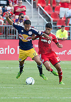 20 July 2013: Toronto FC midfielder Matias Laba #20 and New York Red Bulls midfielder Tim Cahill #17 in action during an MLS regular season game between the New York Red Bulls and Toronto FC at BMO Field in Toronto, Ontario Canada.<br /> The game ended in a 0-0 draw.
