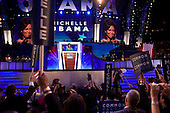 Denver, Colorado<br /> August 25, 2008<br /> <br /> The opening day of the Democratic National Convention in the Pepsi Center. The crowd listens to Michelle Obama, the wife of Illinois Sen. Barak Obama, democratic presidential candidate as she speaks at the convention.