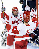Joe Pereira (BU - 6) celebrates with Charlie Coyle (BU - 3). - The Boston University Terriers defeated the visiting University of Toronto Varsity Blues 9-3 on Saturday, October 2, 2010, at Agganis Arena in Boston, MA.