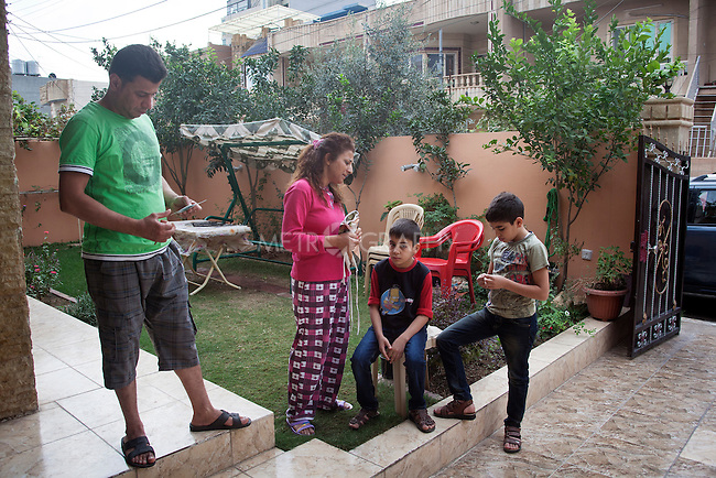 10/31/14. Erbil, Iraq.<br /> At early morning Suzan spook to Wassam and Milad before they leaving, She said &quot;Now you are going back to Alqosh and please be good with School and keep study well and be good on the orphanage&quot;.