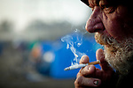 """Battery Bob"" smokes in the SafeGround camp in Sacramento, Calif., January 15, 2011."