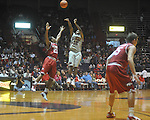 "Ole Miss guard Chris Warren (12)  shoots over Arkansas' Julysses Nobles (23) at C.M. ""Tad"" Smith in Oxford, Miss. on Saturday, March 5, 2010. Mississippi won 84-74."