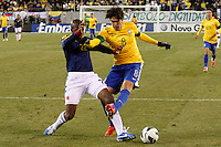 Colombian player Aquivaldo Mosquera (L) fights for the ball with Brazilian player Kaka during their friendly match at MetLife Stadium in East Rutherford New Jersey, November 14, 2012. Photo by Eduardo Munoz Alvarez / VIEWpress.